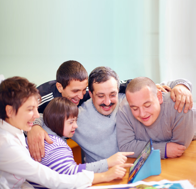 Happy people with disability having fun with tablet