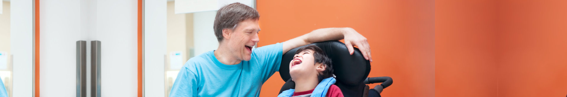man and boy laughing together